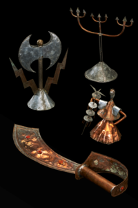 Image of four metal objects: double headed axe with lightning bolts; jewelled cutlass; three tridents on stand; small copper figure.