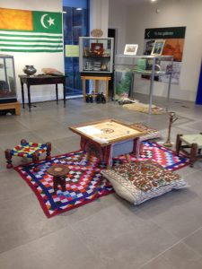 Exhibition space with Kashmiri cushions and board game in centre