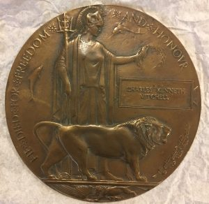Bronze plaque inscribed with Charles Kenneth Mitchell
