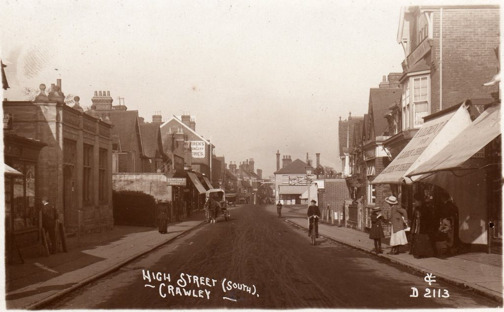 """Sepia photograph of Crawley High Street labelled """"High Street (South), Crawley"""