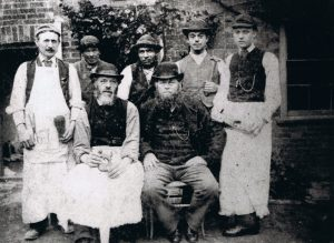 Group of workers in aprons and hats