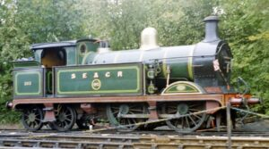 Green locomotive. Number on side - 253. Words on side - S E and C R