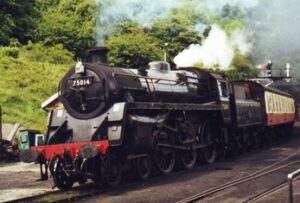 Black locomative in steam, pulling red and cream carriages.
