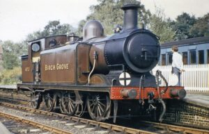 Brown locomotive. writing on side reads: 473. Birch Grove.