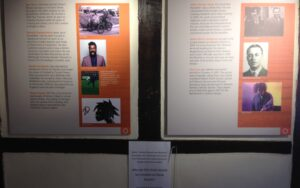 Display board with images and text about 'Characters of Crawley'. These are: Ron Shaw, Romesh Ranganathan, Gareth Southgate, Stuart Harold, John George Haigh, Alfred Morris Jackaman, The Cure.