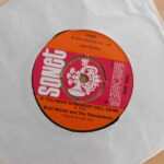 "7"" vinyl record in white sleeve. record is 'If you need somebody call on me' by Brett Marvin and the Thunderbolts."