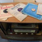 Old vinyl rcords in slev es on the top of a radiogram