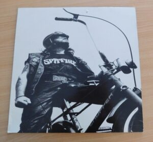 Record sleeve - man on chopper bicycle