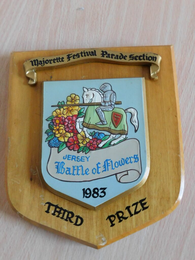Wooden shield reading @Majorette Festival Parade Section. Jersey Battle of Flowers 1983. Third Prize.