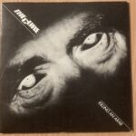 Record Sleeve. Close up of eyes, with words 'The Cure. Killing An Arab'