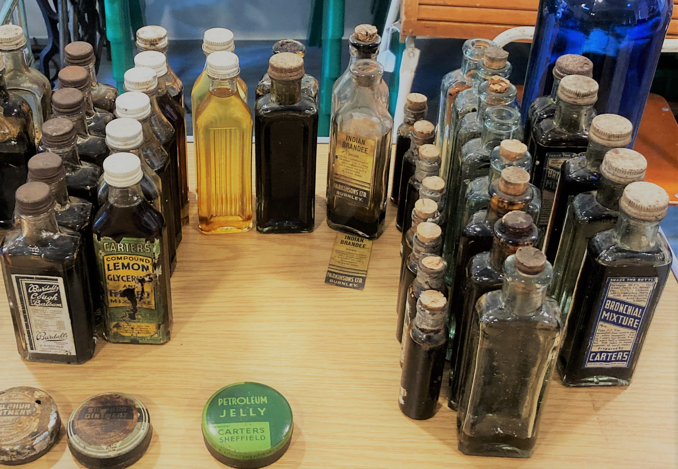 selection of glass medicine bottles filled with liquid